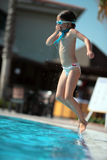 Pool games. Girl jumps in pool. Turkey 2009 royalty free stock image