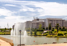 Pool in the garden. Gardens a park from Logroño with pool with water jets in the background are modern buildings forming a development Royalty Free Stock Photos