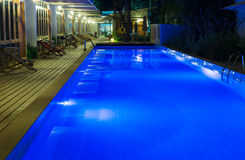 Pool and garden by night Royalty Free Stock Photos