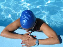 Pool girl. A young girl relaxes while floating in a swimming pool Stock Photo