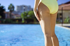 Pool Girl. Girl standing by the swimming pool royalty free stock image