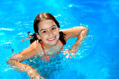 Pool Girl. Happy young girl having fun in the swimming-pool Stock Photography