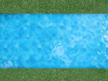 Pool with green grass Stock Photo