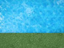 Pool with green grass Royalty Free Stock Image