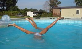 Pool hand stand. Girls having fum in pool Stock Images