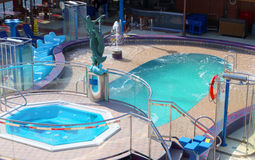 Pool and hot tub on cruise ship. Small swimming pool and hot tub with mermaid statue in the middle on a cruise ship royalty free stock photos
