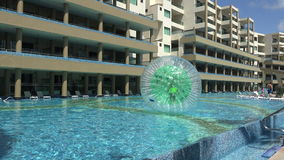 Pool Human Hamster Ball Playing - Far Pan stock footage