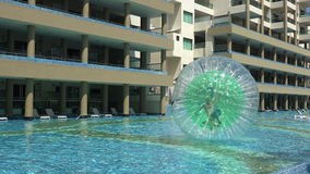 Pool Human Hamster Ball Playing - Medium Pan stock footage