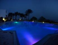 Pool illuminated at night Royalty Free Stock Photography