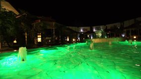 Pool with illumination. Dolly shot. Changing colored lights at night pool stock footage