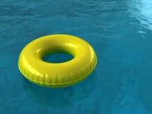 Pool Innertube. Inner Tube on Blue Pool Water Stock Image