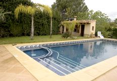 Pool with jacuzzi. Swimming pool with corner jacuzzi Stock Photos