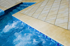 Pool with jacuzzi. Beautiful blue fresh swimming pool with jacuzzi stock images