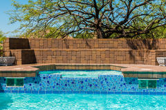 Pool And Jacuzzi. Outdoor pool and jacuzzi with desert background Royalty Free Stock Images