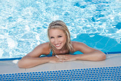 Pool joy. Beautiful young women smiling at camera while standing Royalty Free Stock Photo