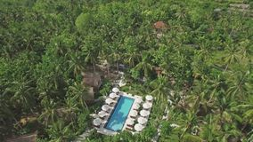 Pool In Jungle Lost Island Tropics Aerial 4k. Aerial footage of a beautiful resort in Nusa Penida, Indonesia stock footage