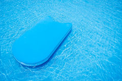 Pool kick board in swimming pool Royalty Free Stock Images