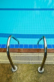 Pool ladder. Swimming pool ladder with blue water Stock Images