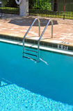 Pool and ladder. Swimming pool and ladder, vertical view Stock Image
