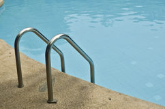 Pool ladder. And swimming pool Royalty Free Stock Photo