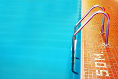 Pool Ladder. With orange tiles stock photography
