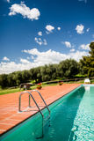 Pool with ladder entrance under the blue sky Stock Image