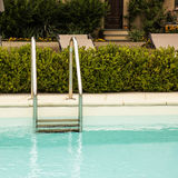 Pool ladder in a garden Stock Photography