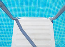 Pool ladder seen from above Royalty Free Stock Photo