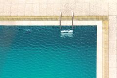 Pool ladders in a Swimming Pool Royalty Free Stock Photos