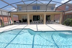 Pool and Lanai. A Back Exterior of a Florida Home with Pool and Lanai Stock Photography