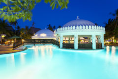 Pool Landscape At Night. Illuminated pool and bar area at night Royalty Free Stock Photos