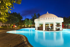 Pool Landscape At Night. Illuminated pool and bar area at night Stock Image