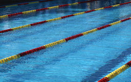 Pool with Lanes. Blue pool with red and yellow lane marker Stock Image