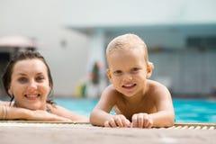 Pool leisure. Portrait of happy mom and son enjoying pool leisure royalty free stock photo