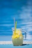 Pool Lemonade. Fresh lemonade at blue pool side royalty free stock photography