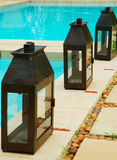 Pool lighting. Lanterns next to a pool Stock Image