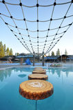 Pool with log floats and ropes for play Royalty Free Stock Photo