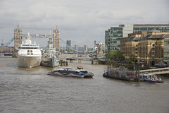 Pool of London ships berthed near Tower Bridge UK Royalty Free Stock Photography
