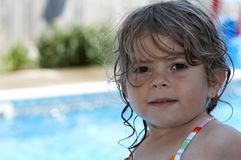 Pool look. A young girl looking at camera buy a pool stock image