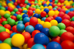 Pool with lots of colorful balls Stock Photo