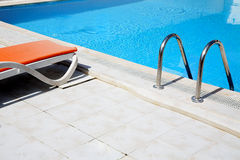 Pool with lounge stock images
