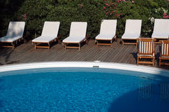 Pool with lounge chairs Stock Image