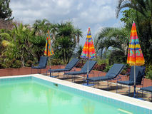 Pool lounge chairs Stock Photography