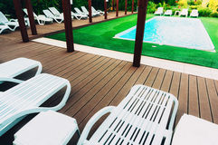 Pool with lounge chairs Royalty Free Stock Photo