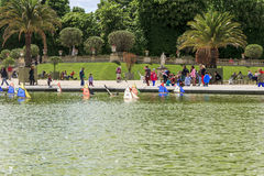 Pool in Luxembourg Garden, Paris. People rest near pool in Luxembourg Garden May 11, 2013 in Paris, France royalty free stock photos