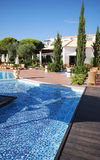 Pool in luxury hotel. Vertical view with swimming pool in luxury hotel Royalty Free Stock Photo