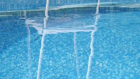 Pool maintenance - float with the preparation for water treatment stock video footage