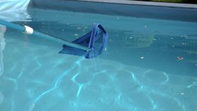 Swimming pool cleaner net slide from left to right stock video