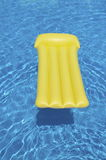 Pool mattress. Yellow inflatable mattress in a pool Stock Images