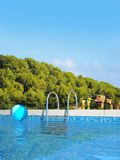 Pool in mediterranean landscape Royalty Free Stock Images